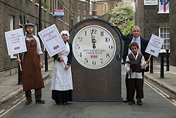© licensed to London News Pictures. London, UK 31/05/2012. TUC General Secretary Brendan Barber (right) posing with people look like Victorian workers and a six foot clock as TUC launches employment rights campaign today in London (31/05/12). Photo credit: Tolga Akmen/LNP