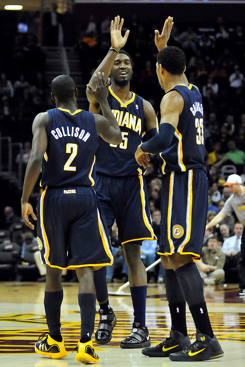 Feb. 2, 2011; Cleveland, OH, USA; Indiana Pacers point guard Darren Collison (2) center Roy Hibbert (55) and small forward Danny Granger (33) celebrate after a basket during the first quarter against the Cleveland Cavaliers at Quicken Loans Arena. Mandatory Credit: Jason Miller-US PRESSWIRE