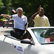 """Trainer Ray Rinaldi and professional boxer Ryon """"Big Youth"""" McKenzie are seen in the parade of champions during the 2013 International Boxing Hall of Fame induction ceremony  on Sunday, June 9, 2013 in Canastota, New York.  (AP Photo/Alex Menendez)"""