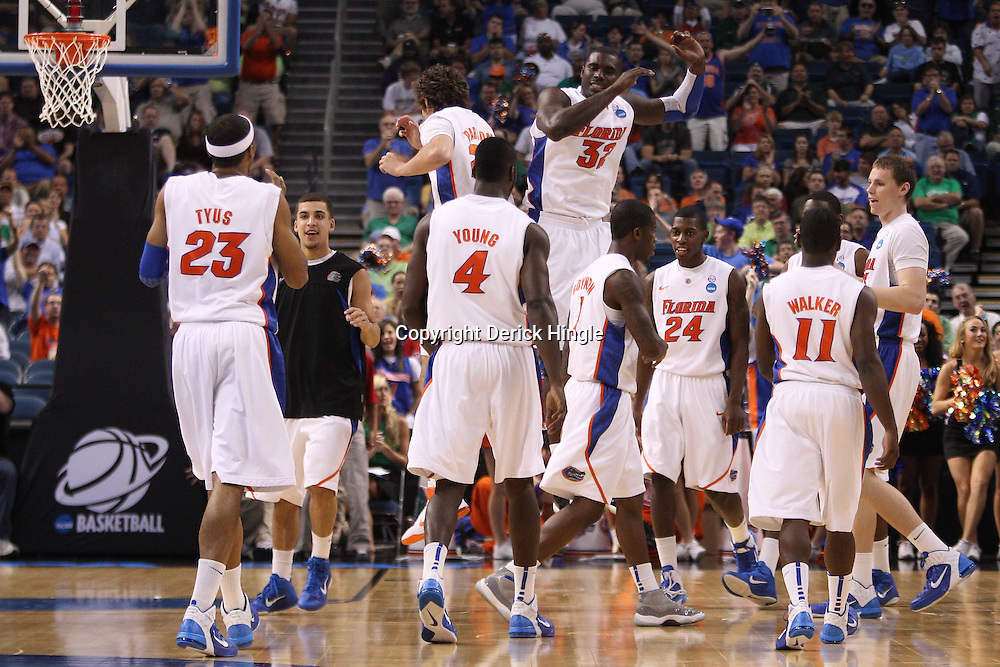 Mar 17, 2011; Tampa, FL, USA; Florida Gators center Vernon Macklin (32) and forward Chandler Parsons (25) celebrate with teammates during first half of the second round of the 2011 NCAA men's basketball tournament against the UC Santa Barbara Gauchos at the St. Pete Times Forum.  Mandatory Credit: Derick E. Hingle