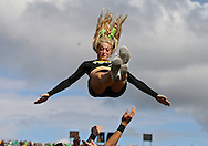 September 24, 2011: An Iowa Hawkeyes cheerleader flies through the air during the second quarter of the game between the Iowa Hawkeyes and the Louisiana Monroe Warhawks at Kinnick Stadium in Iowa City, Iowa on Saturday, September 24, 2011. Iowa defeated Louisiana Monroe 45-17.