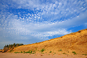 Red cliffs and clouds along Aspy Bay<br /> Cabot Landing Provincial Park<br /> Nova Scotia<br /> Canada
