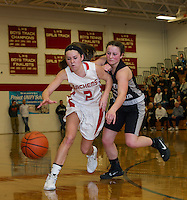 Laconia's Kalie Nute and Prospect Mountain's Delia Everhart go after a loose ball during NHIAA Division III second round tournament game Thursday night at Laconia High School.  (Karen Bobotas/for the Laconia Daily Sun)