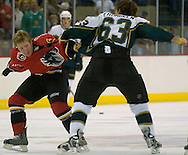 9/29/05  Omaha, NE Omaha Knight's Ryan Cuthbert squares off with the Stars' BJ Crombeen at the Omaha Civic Auditorium Thursday night,.(photo by chris machian/Omaha Magazine)