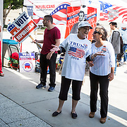 The Democratic and Republican parties set-up voter registration tents immediately outside the naturalization ceremony. Over 6,600 Immigrants from more than 130 countries were sworn in as new citizens of the United States and were solicited by both parties to sign-up so they can vote in the 2016 election.