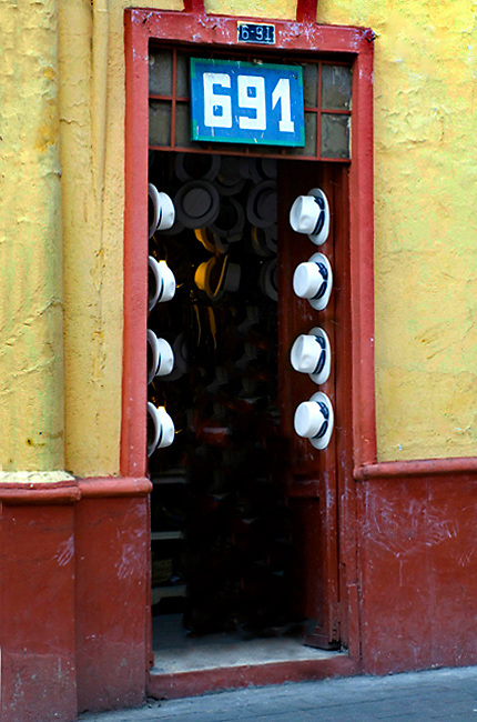 Entrance on Calle Larga to Cuenca's most famous Panama hat maker, sombrerero Alberto Pulla, who has been making Panama hats for many years in Cuenca, Ecuador.  The Panama hat originated in Ecuador.