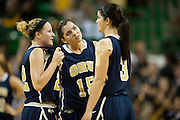 WACO, TX - DECEMBER 12:  Kevi Luper #15 of the Oral Roberts University Golden Eagles looks on with teammates Jaci Bigham #22 and Taylor Cooper #3 against the Baylor University Bears on December 12, 2012 at the Ferrell Center in Waco, Texas.  (Photo by Cooper Neill/Getty Images) *** Local Caption *** Kevi Luper