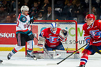 KELOWNA, CANADA - MARCH 13:  Leif Mattson #28 of the Kelowna Rockets looks for the puck as Bailey Brkin #31 of the Spokane Chiefs defends the net during second period on March 13, 2019 at Prospera Place in Kelowna, British Columbia, Canada.  (Photo by Marissa Baecker/Shoot the Breeze)