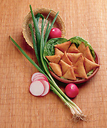 Deep fried triangular savoury pastry with spring onion and radish. This dish is originally from Kurdistan