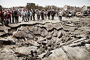 May 10, 2012-Damascus , Syria: People look to a a huge hole in the middle of the street caused by the explosion of a car was loaded with explosives materials . The explosion targeted al -Qazaz crowded intersection at the southern ring-road in Damascus during the morning rush hour on Thursday and caused the death of at least 55 people and 372  injured .