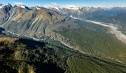 Constantine Metal Resources Ltd. of Vancouver, British Columbia along with investment partner Dowa Metals &amp; Mining Co., Ltd. of Japan is exploring a potential site for a mine (located on the upper left side of image) just above Glacier Creek (foreground) and the Klehini River (right side of image). The border with British Columbia is at the upper right. The area above Glacier Greek, known as the Palmer Deposit is located near mile 40 of the Haines Highway.<br /> <br /> The minerals that Constantine&rsquo;s drilling explorations have found are primarily copper and zinc, with significant amounts of gold and silver. Exploratory drilling to refine the location and mineral amounts are the current focus of the company.<br /> <br /> If approved and developed, the mine, near Haines, Alaska would be an underground mine. Besides the actual ore deposits, having the nearby highway access for transporting ore to the deepwater port at Haines is also attractive to Constantine. The Haines Highway can be seen in photo on the right.<br /> <br /> Support for a large scale mine such as the Constantine project is divided among residents of Haines, a small community in Southeast Alaska 75 miles northwest of Juneau. The community&rsquo;s needed economic boost from jobs, development and other mine support that a large-scale mine brings is tempting to some. To others, anything that might put the salmon spawning and rearing habitat and watershed resources at risk is simply unimaginable and unacceptable. Of particular concern is copper and other heavy metals in mine waste leaching into the Klehini River (shown) and the Chilkat River 14 miles downstream. Copper and heavy metals are toxic to salmon and bald eagles.<br /> <br /> The Chilkat River chum salmon are the primary food source for one of the largest gatherings of bald eagles in the world. Each fall, bald eagles congregate in the Alaska Chilkat Bald Eagle Preserve, located only three miles downriver from the area of current exploration.