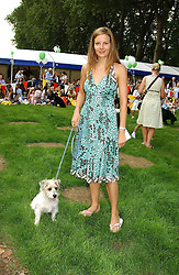 MISS JESSICA SIMON and her dog Samba at the Macmillan Cancer Relief Dog Day held at the Royal Hospital Chelsea South Grounds, London on 6th July 2004.