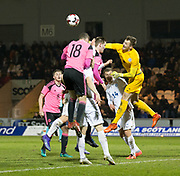 Estonia's Andreas Vaikla punches the ball off Scotland's Alex Iacovitti's head - Scotland under 21s v Estonia international challenge match at St Mirren Park, St Mirren. Pic David Young<br />  <br /> - &copy; David Young - www.davidyoungphoto.co.uk - email: davidyoungphoto@gmail.com