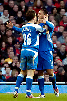 Photo: Ed Godden/Sportsbeat Images.<br /> Arsenal v Wigan Athletic. The Barclays Premiership. 11/02/2007. Wigan's Leighton Baines (L) and Denny Landzaat celebrate after Landzaat put the away team 1-0 up.