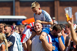 A young fan and his dad enjoy the outside big screen - Ryan Hiscott/JMP - 07/07/2018 - FOOTBALL - Ashton Gate - Bristol, England - Sweden v England, World Cup Quarter Final, World Cup Village at Ashton Gate
