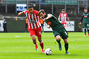 Graham Carey (10) of Plymouth Argyle battles for possession with Noor Husin (16) of Accrington Stanley during the EFL Sky Bet League 2 match between Plymouth Argyle and Accrington Stanley at Home Park, Plymouth, England on 1 April 2017. Photo by Graham Hunt.