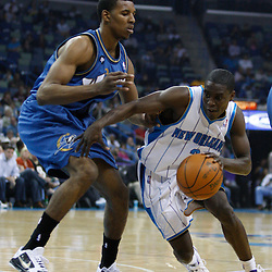 Mar 31, 2010; New Orleans, LA, USA; New Orleans Hornets guard Darren Collison (2) drives past Washington Wizards guard Nick Young (1) during the first half at the New Orleans Arena. Mandatory Credit: Derick E. Hingle-US PRESSWIRE