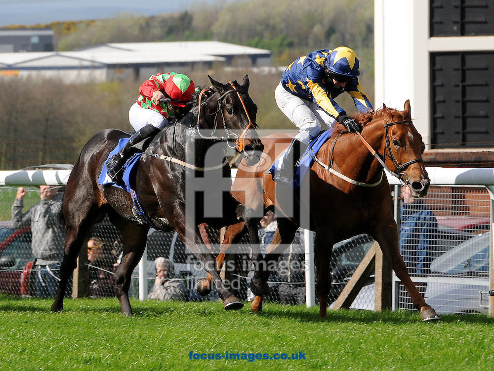 New Bidder and jockey Russ Kennemore (l) win The Racing UK Handicap Stakes from See The Sun (David Allan) at Pontefract Racecourse, Pontefract<br /> Picture by Alan Wright/Focus Images Ltd 07733 196489<br /> 08/04/2014
