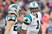 CHICAGO, IL - OCTOBER 22:  Cam Newton #1 talks on the field with Christian McCaffrey #22 of the Carolina Panthers during a game against the Chicago Bears at Soldier Field on October 22, 2017 in Chicago, Illinois.  The Bears defeated the Panthers 17-3.  (Photo by Wesley Hitt/Getty Images) *** Local Caption *** Cam Newton; Christian McCaffrey