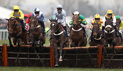 Santini ridden by Nico de Boinville (centre) jumps a fence before winning the Doom Bar Sefton Novices' Hurdle during Ladies Day of the 2018 Randox Health Grand National Festival at Aintree Racecourse, Liverpool.
