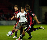 Photo: Leigh Quinnell.<br /> AFC Bournemouth v Bristol City. Coca Cola League 1. 26/09/2006. Bristol Citys Scott Brown is surrounded by Bornemouth players.