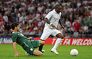 Jermain Defoe takes on defender Bojan Jokic during the international friendly match between England and Slovenia at Wembley Stadium, London on the 5th September 2009
