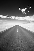 An infrared image of a desolate road in Death Valley National Park.