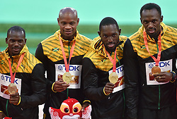30-08-2015 CHN: IAAF World Championships Athletics day 9, Beijing<br /> 400 m relay  Nesta CARTER, Asafa POWELL, Nickel ASHMEADE en Usain BOLT JAM<br /> Photo by Ronald Hoogendoorn / Sportida