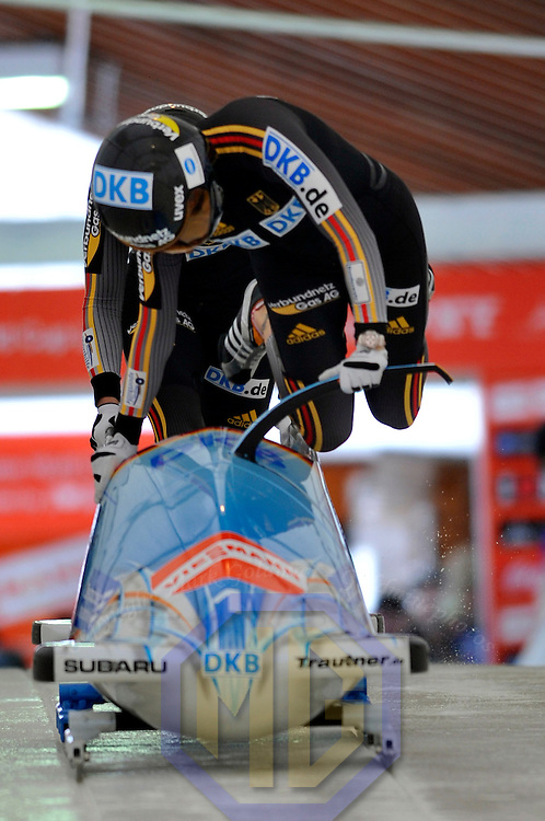 15 December 2007:  The Germany 1 sled driven by Sandra Kiriasis with Romy Logsch on the brakes slide to a first place finish at the FIBT World Cup Women's bobsled competition on December 15, 2007 at the Olympic Sports Complex in Lake Placid, NY.  with a time of 1:54.10