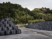 Thousands of black sacks containing radiation-contaminated soil and other debris sit at an interim storage facility near Tomioka, Japan.