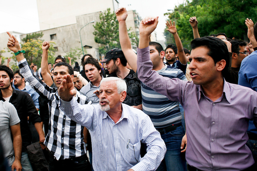 13 June, 2009. Tehran, Iran. Supporters of reformist candidate Mir Hossein Moussavi protest against the results of the elections of June 12th. Police clamped down on supporters of the opposition candidate, Mir Hussein Moussavi, who said the election was stolen by President Ahmadinejad. Conservative reformist candidate Mir Hossein Mousavi is ran against the ultra-conservative current President of Iran Mahmoud Ahmadinejad.<br /> &copy;2009 Gianni Cipriano<br /> cell. +1 646 465 2168 (USA)<br /> cell. +39 328 567 7923<br /> gianni@giannicipriano.com<br /> www.giannicipriano.com
