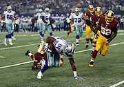 Dallas Cowboys wide receiver Terrance Williams (83) regains his balance after breaking a tackle attempt by Washington Redskins free safety David Amerson (39) as he catches a first quarter pass that gives the Cowboys first and goal at the 8 yard line during the NFL week 6 football game against the Washington Redskins on Sunday, Oct. 13, 2013 in Arlington, Texas. The Cowboys won the game 31-16. ©Paul Anthony Spinelli