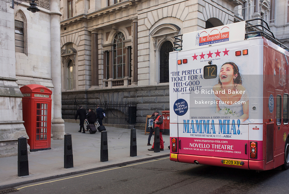 Bus rear advertising for Abba's West End musical Mamma Mia as it drives through City of London streets.