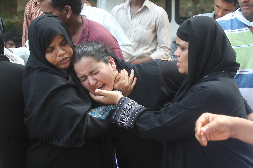 Family members of deceased passengers break down outside a mourtary, after identifying their kith and kin, on May 23, 2010 in Mangalore. An Air India Express Dubai-Mumbai Boeing 737-800 series aircraft overshot the runway on arrival and crashed into a forest. Airline officials say 8 people have been rescued while nearly 160 others are feared dead. (Photo by Prashanth Vishwanathan/Getty Images)