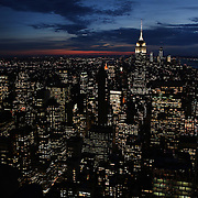 A panoramic view of Manhattan, New York, at dusk from the Top of the Rock, the observatory deck at Rockefeller Center showing the Empire State Building, Manhattan, New York, USA.  Photo Tim Clayton