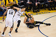 Golden State Warriors forward Andre Iguodala (9) snags a loose ball against the San Antonio Spurs during Game 2 of the Western Conference Quarterfinals at Oracle Arena in Oakland, Calif., on April 16, 2018. (Stan Olszewski/Special to S.F. Examiner)