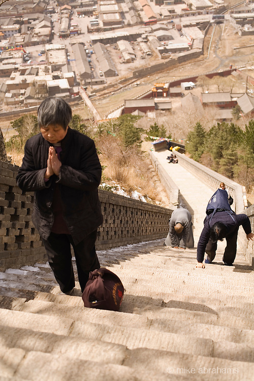 Pilgrims climbing up the steps to a temple in Wutai Shan, People's Republic of China