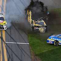 Jeff Green (10) and Regan Smith (7) crash on the front stretch during the Alert Today Florida 300 XFinity Series race at Daytona International Speedway on Saturday, February 21, 2015 in Daytona Beach, Florida.  (AP Photo/Alex Menendez)