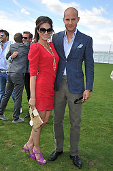 SASKIA BOXFORD and GUNNAR WINBERGH at the 27th annual Cartier International Polo Day featuring the 100th Coronation Cup between England and Brazil held at Guards Polo Club, Windsor Great Park, Berkshire on 24th July 2011.