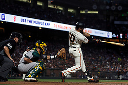 SAN FRANCISCO, CA - AUGUST 13: Evan Longoria #10 of the San Francisco Giants hits an RBI double against the Oakland Athletics during the sixth inning at Oracle Park on August 13, 2019 in San Francisco, California. The San Francisco Giants defeated the Oakland Athletics 3-2. (Photo by Jason O. Watson/Getty Images) *** Local Caption *** Evan Longoria