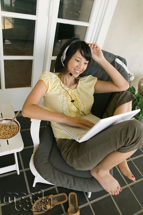 Woman Relaxing on Porch