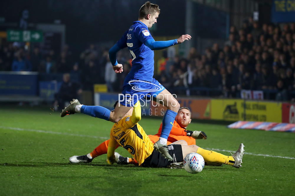 Southend United goalkeeper Mark Oxley (1) saves from AFC Wimbledon attacker Marcus Forss (15) during the EFL Sky Bet League 1 match between AFC Wimbledon and Southend United at the Cherry Red Records Stadium, Kingston, England on 1 January 2020.