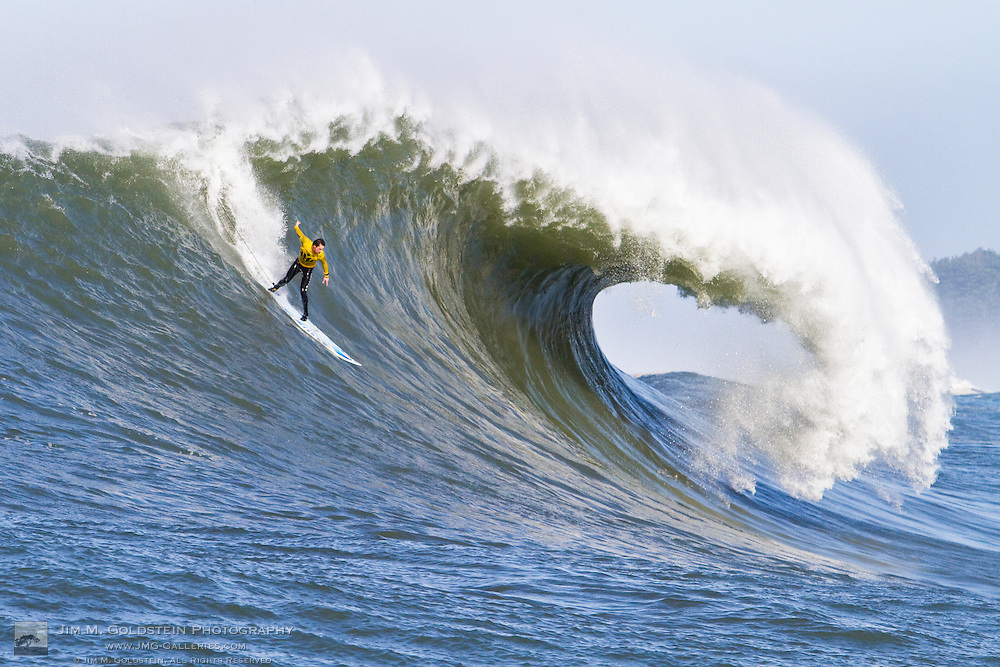 "Kenny ""Skindog Collins drops into a huge wave at the 2010 Mavericks Surf Contest held in Half Moon Bay, California on February 13, 2010"