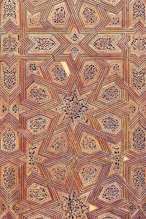 FEZ, MOROCCO - 1st DECEMBER 2016 - Intricate wooden carving work at the Bou Inania Madrasa, Koranic School, Fez Medina, Middle Atlas Mountains, Morocco.