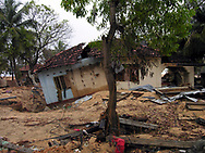A home destroyed by the December 26, 2004 Tsunami that struck S.E. Asia following a 9.0 earthquake in the Indian Ocean. Batticaloa, Sri Lanka. 11/01/2005. Photo © J.B. Russell