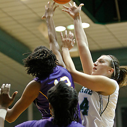 November 19, 2011; New Orleans, LA; Tulane Green Wave guard/forward Janique Kautsky (24) has her shot blocked by LSU Lady Tigers forward Krystal Forthan (12) during the first half of a game at Avron B. Fogelman Arena.  Mandatory Credit: Derick E. Hingle-US PRESSWIRE