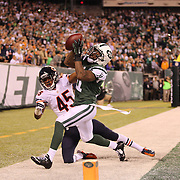 Jeremy Kerley, New York Jets, catches a fourth down play out of the end zone while challenged by Brock Vereen, Chicago Bears,  during the New York Jets Vs Chicago Bears, NFL regular season game at MetLife Stadium, East Rutherford, NJ, USA. 22nd September 2014. Photo Tim Clayton for the New York Times