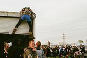 Woman climbing a Van, Avonmouth, Bristol, UK, June 2014.