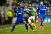 Lewis Stevenson (#16) of Hibernian FC holds off Daniel Candeias (#21) of Rangers FC during the Ladbrokes Scottish Premiership match between Hibernian and Rangers at Easter Road, Edinburgh, Scotland on 8 March 2019.