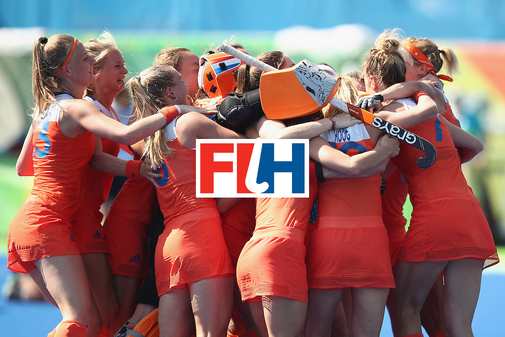 RIO DE JANEIRO, BRAZIL - AUGUST 17:  The Netherlands celebrate victory in the penalty shootout during the womens semifinal match between the Netherlands and Germany on Day 12 of the Rio 2016 Olympic Games at the Olympic Hockey Centre on August 17, 2016 in Rio de Janeiro, Brazil.  (Photo by Mark Kolbe/Getty Images)